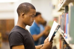 College Grants For African American Males Black Male Student Reading Book